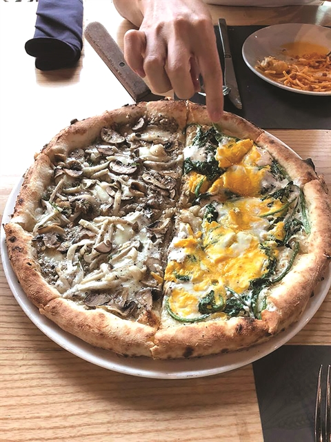 Mix and match: Two toppings on one pizza - mushrooms, egg and spinach pizza. VNS Photo Mỹ Hà