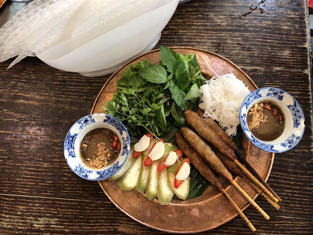 Rock and roll: Nem lụi, or pork paste roasted on charcoal, a popular dish originally from Huế in the old menu. — VNS Photo Mỹ Hà