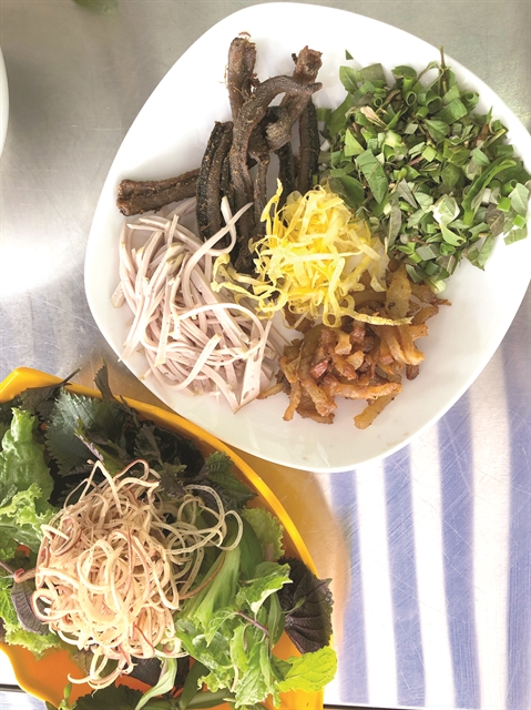 EEL-Y GOOD: Headlined by the eels, bún thang Phố Hiến can be eaten with fresh herbs and sliced banana flower. — VNS Photos Mỹ Hà