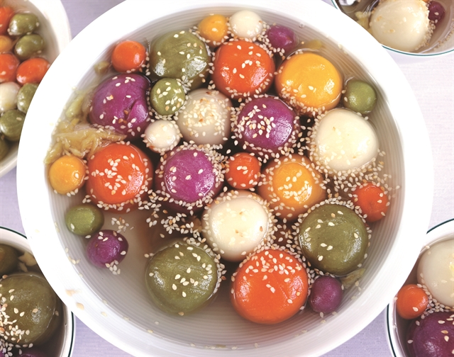 Chè trôi nước ngũ sắc (five-coloured floating rice-ball pudding) is a dessert made of glutinous rice filled with mung bean paste bathed in a sweet liquid made of water, sugar, and grated ginger root. —VNS Photo Ngọc Diệp