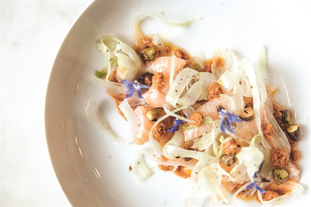 Marinated salmon carpaccio is a favourite of seafood lovers. VNSphoto Minh Phi