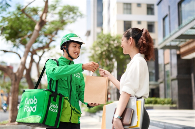 Grab – Southeast Asia's leading multi-service super app – recently launched a central kitchen, GrabKitchen, in HCM City after weeks of trialling the model.— Photo Grab