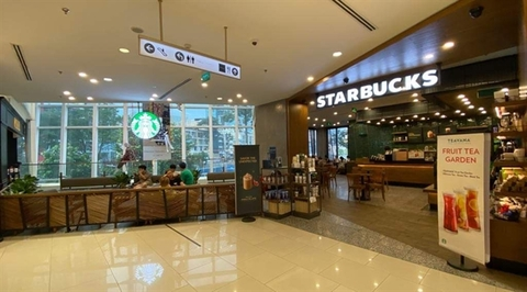 A coffee store at a trade centre in District 1 in HCM City. Food and beverage and fashion and lifestyle will continue to drive demand in HCM City's retail property market. — VNS Photo Thu Ngan