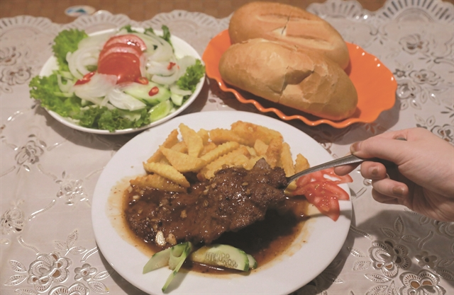 DIG IN: The medium-well done beef steak is the speciality of the restaurant.