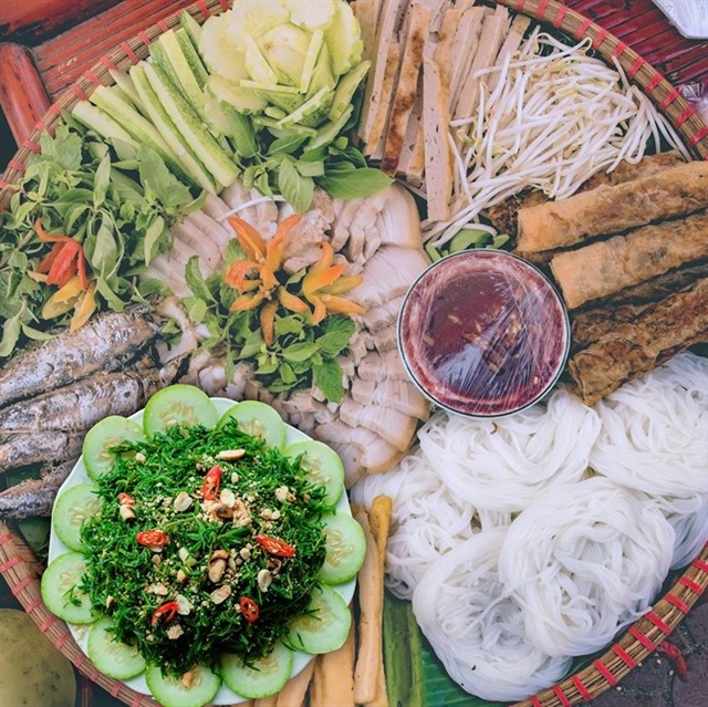 Kicker: Nhót vegetables can be savoured as a side dish with rice cakes, Nghệ An stuffed pancakes and vermicelli with shrimp paste. — VNS photos